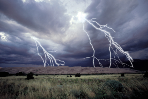 Landscape with lightning bolts from storm